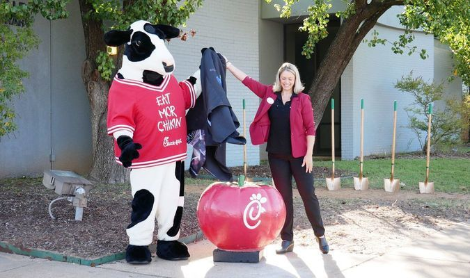 Photo courtesy of the City of Jacksonville  Franchise owner Marybeth Wade and the Chick-fil-A mascot unveil the owner of Jacksonville's newest eatery during a press announcement Wednesday at the site of the former public library.