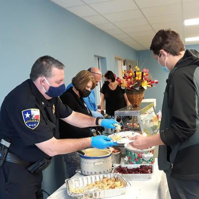 Holiday fixin's   Rusk Police Chief Stephen Hughes dishes up turkey and dressing Tuesday, during the annual Rusk Community Thanksgiving luncheon. Volunteers – such as City Secretary Cinda Etheridge (center left) and RPD Detective Nate Acker – prepare and serve the meal, which is free to diners. The Rusk luncheon is the first of several Thanksgiving community meals held in Cherokee County. See story on Page 1 for a list of other holiday meals.   Photo by Jo Anne Embleton