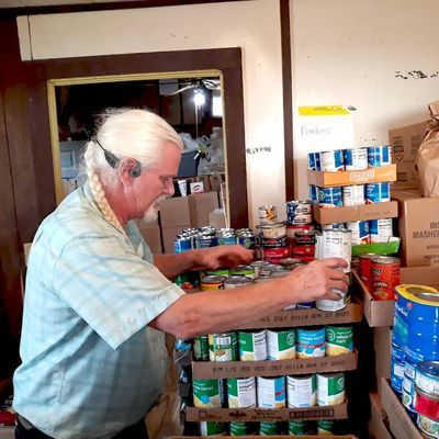 Murray Smith, director of Rusk's Good Samaritan Food Pantry, helps stock donations for future use. According to Good Samaritan officials, the impact of a national pandemic has hit organizations like them hard.  Photo by Jo Anne Embleton