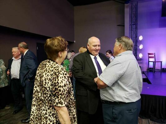 Outgoing Jacksonville College President Dr. Mike Smith enjoys a visit with a well-wisher at his reception May 8 at Central Baptist Church.   Photo by Jo Anne Embleton