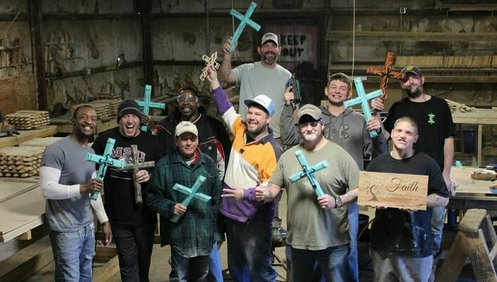 Raising funds  Program participants at The City of Refuge for Men create wooden crosses and wall decor to sell as part of a fundraising effort for a building program at the Mississippi outreach.  Courtesy photo