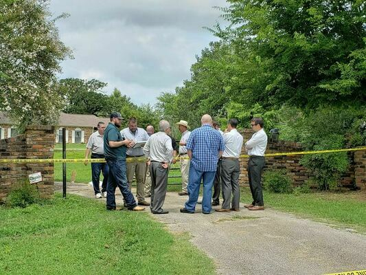 Quadruple homicide – Members of the Cherokee County Sheriff's Department gather at the front gate of a residence approximately 2.0 miles north of the New Summerfield city limits along Texas Highway 110 that was the scene of an early-morning quadruple homicide on July 20. Names of the victims have not been released, pending contact of family members. A search continues for the suspect(s).   Photo by Jo Anne Embleton