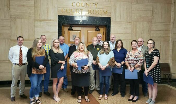 Honored – County employees recognized July 27 for their service. Photo by Jo Anne Embleton