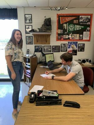 Rusk High School student Annie Beathard presents her bill to U.S. History instructor Adam Nimitz.   Courtesy photo
