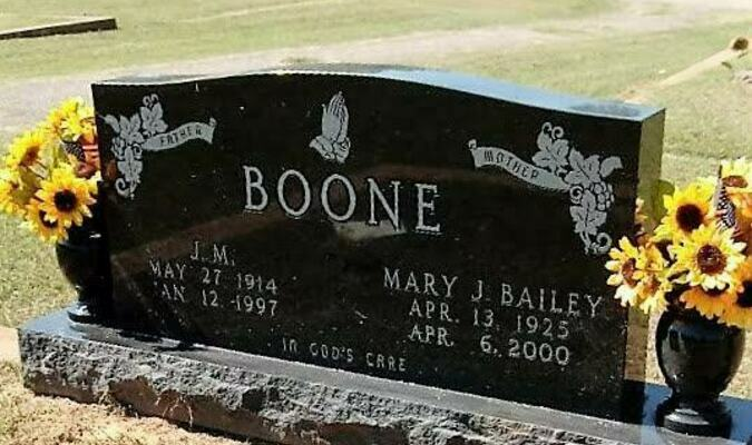 """Beautifying cemeteries  One of the many gravestones cleaned by the """"cemetery angels"""" and flowers placed by the family.   Courtesy photo"""