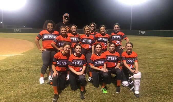 Wells Junior High Lady Pirates wind down after winning the inaugural game of the school's new softball program. The Lady Pirates won their Oct. 8 double-header against Central Heights.   Photo courtesy of Kacie Collins