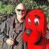 <p>Band director Bud Stewart takes a moment to pose with Clifford the Big Red Dog. FRED RAMEY PHOTO.</p>