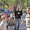 <p>Anna Hess, right, prepares to lead a group of kids and adults on a hike to illustrate Appalachian ecology. RODDY ADDINGTON PHOTO.</p>