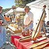 <p>Home Craft Days at Mountain Empire Community College is known for its blend of great live music and displays by great local craftspeople. The 39th annual festival, held last weekend, was no exception, and some people managed to combine the best of both. Here, mountain dulcimer maker Wayne Thomas talks about his craft with Ken and Teresa Sprinkle. ELISSA POWERS PHOTO.</p>