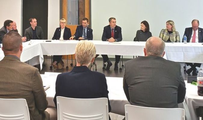 Gov. Ralph Northam, center, leads a discussion with Amazon executives and local officials in St. Paul.  TERRAN YOUNG PHOTO