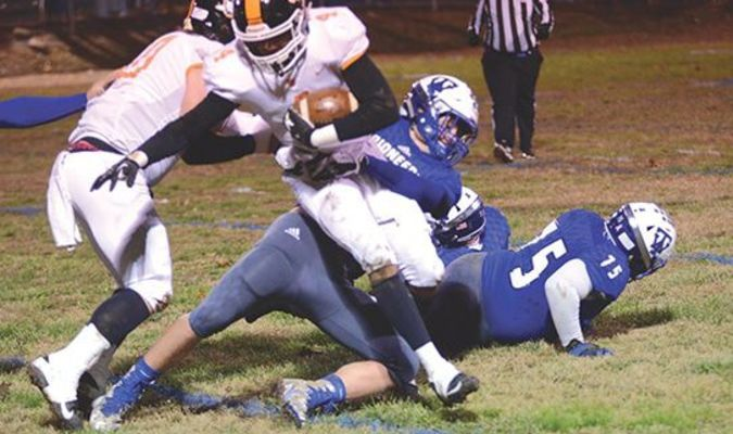 The Raiders' Najee Steele carries the ball and a Thomas Walker defender extra yards for a first down. PHOTO BY KELLEY PEARSON