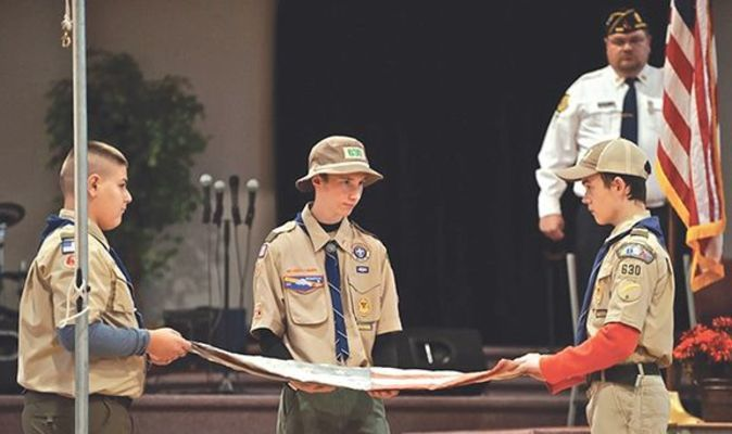 Boy Scouts Gabe Ringley, Ethan Sturgill and Tavish Stratton fold a flag prior to its retirement during last weekend's third annual Celebration of Heroes event celebrating Veterans Day.  MICHELLE MULLINS PHOTO
