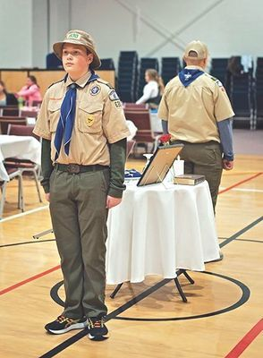 Scouts from Troop 630 stand vigil over the Missing Man Table.  MICHELLE MULLINS PHOTO