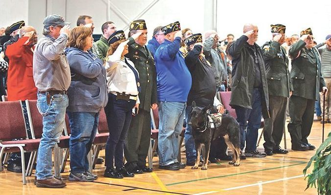 Veterans salute the flag.  MICHELLE MULLINS PHOTO