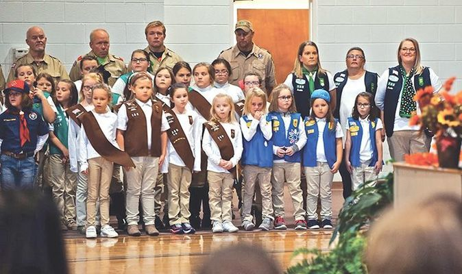 Members of Girl Scout Troops 188 and 389 honoring our veterans and first responders.   MICHELLE MULLINS PHOTO