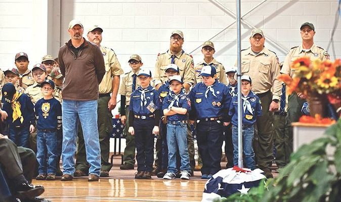 Members of Cub Scout Pack 603 salute our veterans and first responders.   MICHELLE MULLINS PHOTO