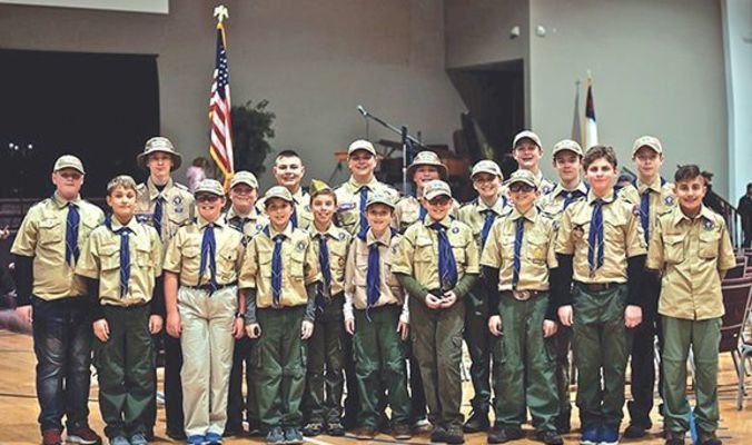 Members of Boy Scout Troop 630 continue the tradition of honoring local veterans.   MICHELLE MULLINS PHOTO
