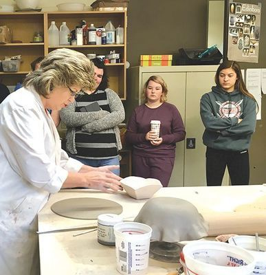 Professor Suzanne Adams-Ramsey and students in her Gallery Internship class are using their artistic skills to combat hunger.