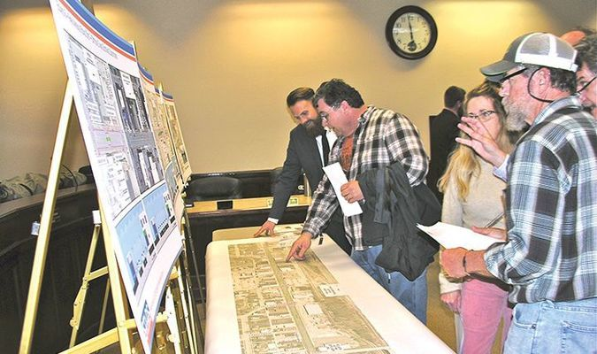 During a Wednesday event at city hall, Norton residents Gordon and Jane Sandt, right, examine Virginia Department of Transportation maps showing traffic management options for the downtown corridor. Public comments on downtown traffic are being accepted through Jan. 25.  JEFF LESTER PHOTO