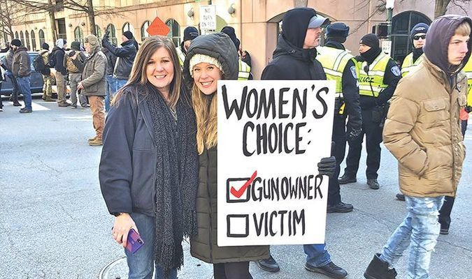 Appalachia resident Jennifer Bargo, left, poses with a newfound friend Monday as tens of thousands of gun rights advocates gathered for a rally at the state Capitol in Richmond. PROVIDED BY JENNIFER BARGO