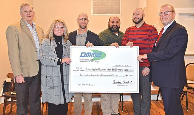 Officials gathered Friday in St. Paul for the funding presentation. Left to right are Butch Lambert, Virginia Department of Mines, Minerals and Energy; Lou Wallace, Russell County Board of Supervisors; Brad Kreps, The Nature Conservancy; Shawn Lindsey, Spearhead Trails; Josh Sawyer, St. Paul Town Council; and Congressman Morgan Griffith.  DMME PHOTO