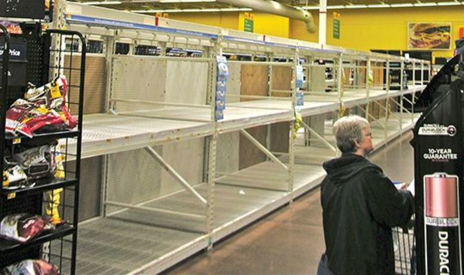 Monday afternoon, the shelves for toilet paper and other paper products were cleaned out at the Norton Walmart store, following a nationwide trend of panicked shopping by people who expect to lay low during the coronavirus outbreak.  JEFF LESTER PHOTO
