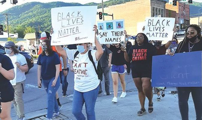 People rallying in protest against violence toward blacks march through Big Stone Gap Sunday.  KELLEY PEARSON PHOTO