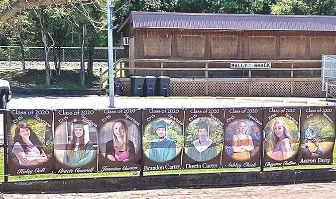 Eastside High School is honoring its graduating seniors with banners that were hung Thursday along Front Street near the depot. SHARON STILL PHOTO