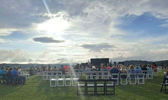 Central High School's graduating seniors received their diplomas July 30 in an outdoor ceremony facing a dramatic backdrop of an early evening sun and the ridgelines near the school.  KELLEY PEARSON PHOTO