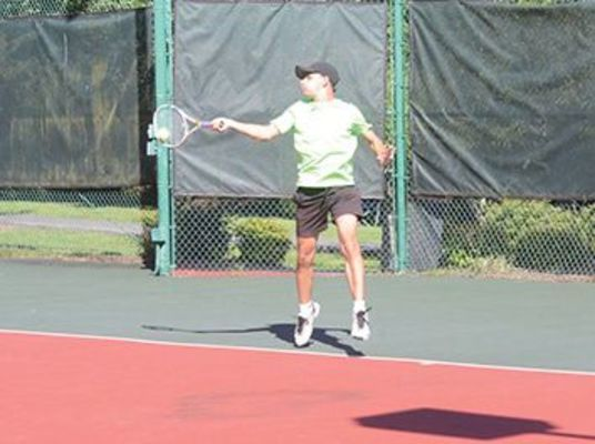 Hugo Retortillo shows off his skills in tennis action.