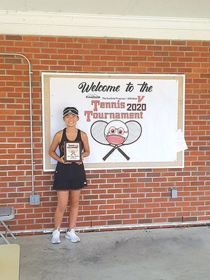 Jaida Meade is victorious in the girls' division of the Coalfield Progress-UVA Wise tennis tournament last weekend.