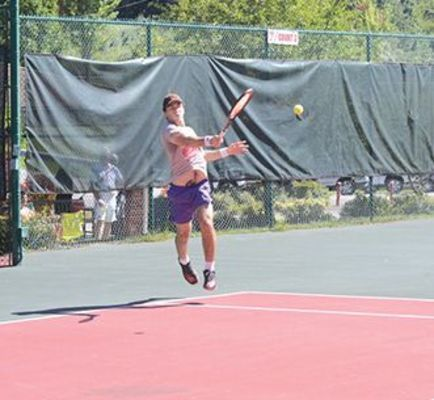 Sean Given blasted this return to win the men's B singles division.