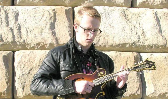 Thomas Cassell was a Burton High School senior in 2015 when this photo was taken for an interview about his emerging recognition as a mandolin virtuoso. FILE PHOTO