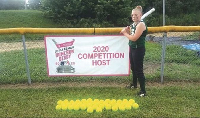 Brooklyn Rutherford poses with her 40 home run balls during the 2020 little league season.SUBMITTED PHOTO
