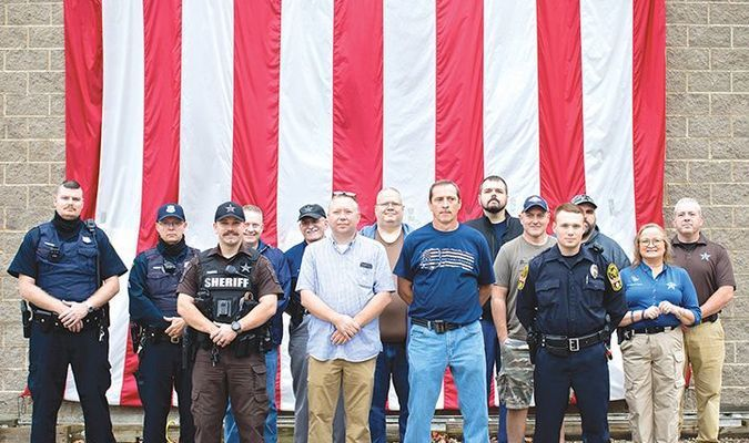 Norton Police Chief James Lane, Wise County Sheriff Grant Kilgore and other members of law enforcement pose Saturday during a Back the Blue rally in Norton.  JESSICA HOOD PHOTO