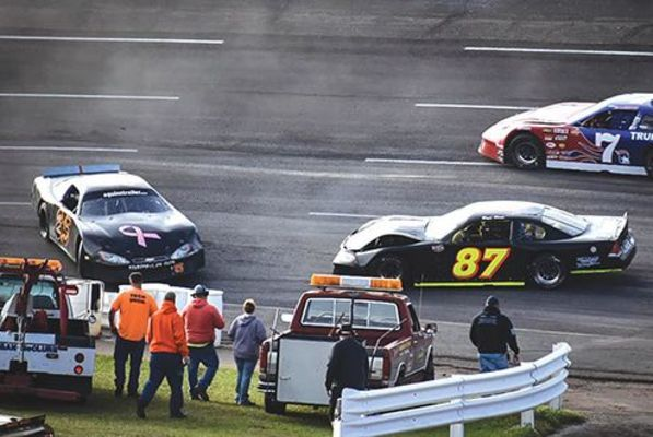 Jacob York (25) and Bryce Blake (87) got a little too close for comfort during the first Limited Late Model division race. PHOTO BY RJ ROSE