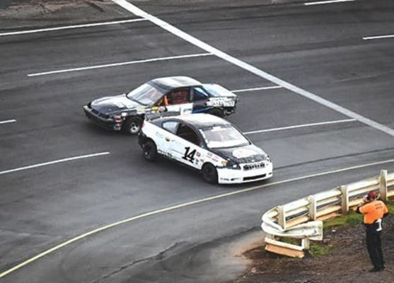 Josh Trinkle (14) spins out going through turn three and Tony Casteel (4C) is unable to avoid the crash. PHOTO BY RJ ROSE