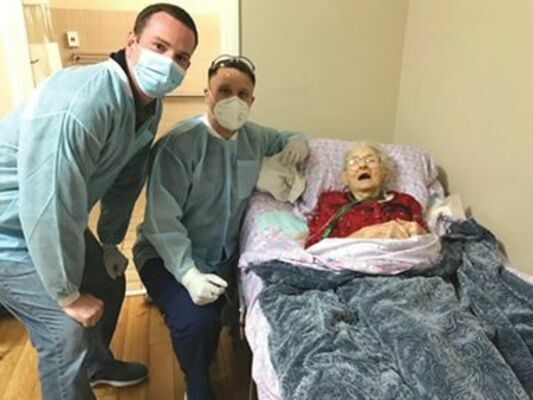 Dr. Mark Raymond and Devin Cradic with 102-year-old Mildred Adams.