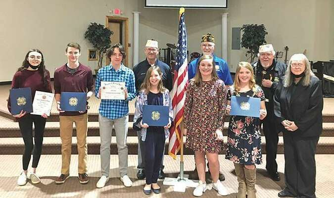 Six young writers recently received honors for their patriotic essays during a ceremony at Rejoice Learning Center in Castlewood. They are the 2020-21 winners from Mountain Empire Veterans of Foreign Wars Post 8652 in Coeburn, Keith Maggard VFW Post 4301 in Norton and John Fox Jr. VFW Post 5715 in Big Stone Gap. In the front row, left to right, are Melanie Holbrook, Ethan Owens, Christian Nunley, Caylee Jessee, Kellsie Brown, Madelyn Musick and Ida Lawson, VFW Post 8652 auxiliary president. In the back row are Anthony Willis, commander, Mountain Empire VFW Post 8652; David Jarvis, commander, Keith Maggard VFW Post 4301; and Joe Rasnick, commander, John Fox Jr. VFW Post 5715.  PROVIDED BY ANTHONY WILLIS