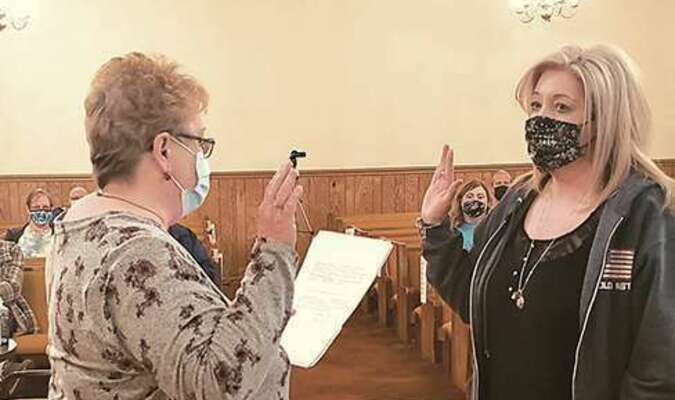 Susan Freeman, right, is sworn in Tuesday night as Pound's newest council member.  APRIL HILL PHOTO