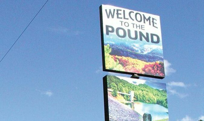 This is the outward-facing side of the new welcome sign at the Historical Society of the Pound building, greeting visitors who enter Pound from the northernmost entry point on U.S. 23.  JEFF LESTER PHOTO