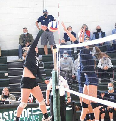 Eastside's Anna Whited slams a kill through the Patrick Henry block Friday evening. PHOTO BY KELLEY PEARSON