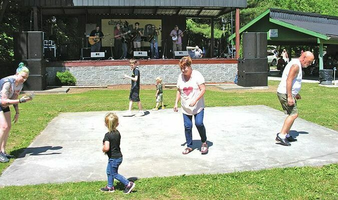 Flatfooters dance to the sound of Bluegrass Circle Saturday afternoon during the 23rd annual Clinch River Days in St. Paul.  JEFF LESTER PHOTO