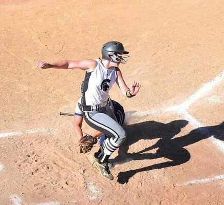 Eastside's Anna Whited jukes out of the way of the tag to score a run Thursday at Northwood. PHOTO BY KELLEY PEARSON