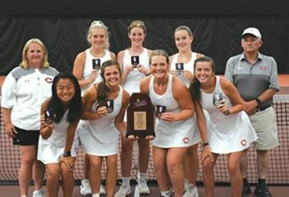The Lady Warriors celebrate winning the first tennis championship in school history after the Class 2 finals at Virginia Tech.
