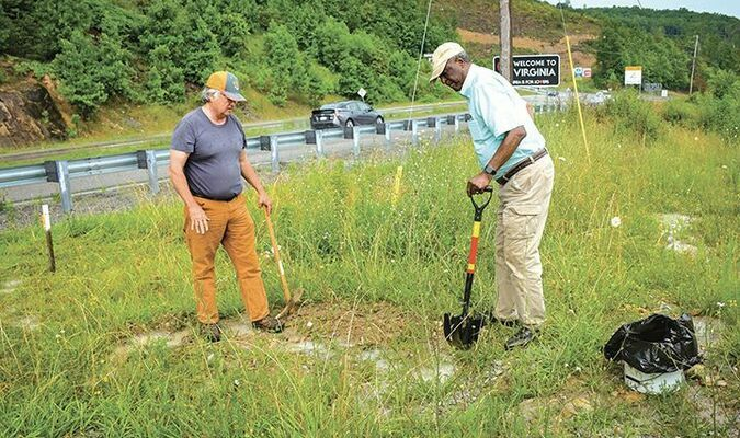 Rev. Preston Mitchell, left, and Frank Gravely collect soil in Pound Gap near the site of a 1927 lynching incident as part of the local Community Remembrance Project. RENEE HODGES PHOTO