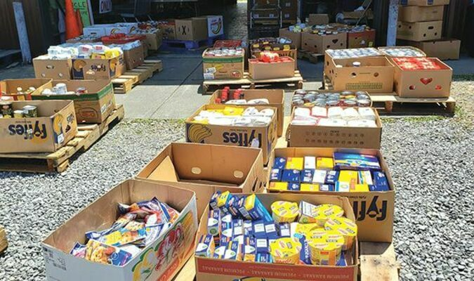 This is just part of the big food donation made Friday to the Wise County Food bank by a visiting Little League team from the Richmond area. The group donated $3,000 worth of food.  MYRA MARSHALL PHOTO