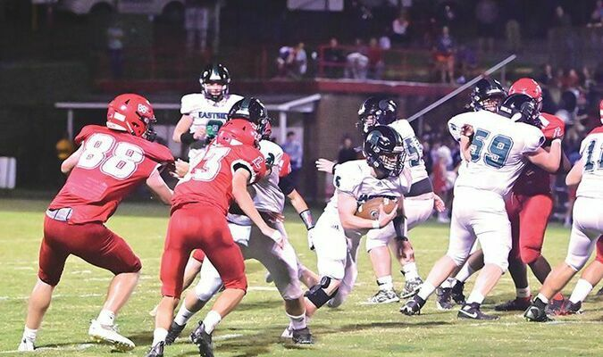 Eastside's Ethan Hill finds a big opening in the Pioneer defensive line. PHOTO BY RICHARD MEADE