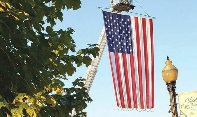 We never tire of seeing our nation's flag on display, especially to honor heroes. This was the scene Sept. 11 in Norton, with help from the city's fire department.  MYRA MARSHALL PHOTO