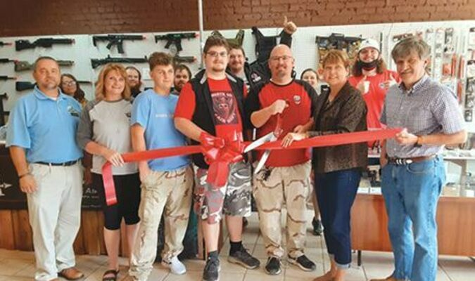 Norton officials, Chamber of Commerce officials and others gathered Oct. 1 to celebrate the opening of North 40 Airsoft in the city. The owners are Jack and Alma Flanary.  CHAMBER OF COMMERCE PHOTO